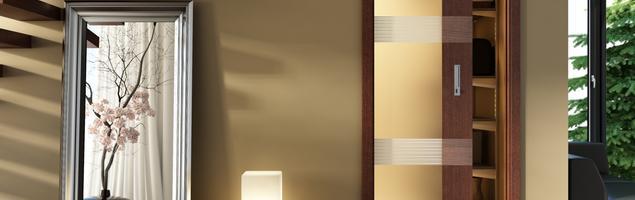 Drzwi przesuwne szklane. Oszczędność miejsca w aranżacji salonu